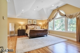 Light-filled Master Bedroom with vaulted ceiling and windows overlooking the backyard.