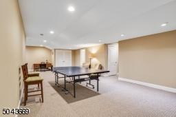 Expansive basement recreation area.