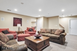 Large basement with recreation room, second laundry room, exercise room and full bath.
