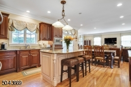 Large Kitchen open to eating area and family room with doors leading to deck.