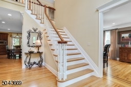 The elegant 2 storey foyer welcomes you to the home, flanked by the living room on one side and formal dining room on the other side,