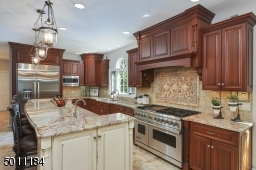 """Ejoy the """"chef's"""" Viking stove and oven, all top of the line SS appliances were used in this kitchen."""