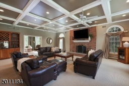 There is nothing like this room!  The coffered ceilings, fireplace, recessed lighting and space gives you a place to read, play game night or watch movies.