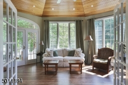 Overlooking the patio/pool, surrounded by windows and sunlight, enjoy your morning coffee in this cozy room /