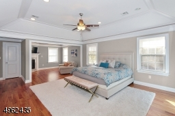 Spacious master bedroom featuring a sitting rm w/gas fp, tray ceiling, his & her custom walk-in closets and elegant bath (his & her sep vanity), spa like shower & soaking tub!