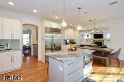 Butlers pantry, wine cooler, walk-in dry pantry, mudrm & access out to garage