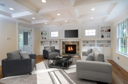 Custom built-ins, gas fireplace, coffered ceiling