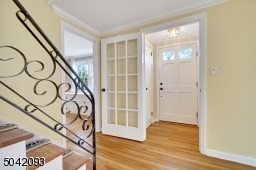 Enclosed vestibule entry with coat closet and additional door for added privacy.