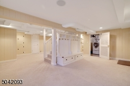 Carpet and Recess Lighting provide a warm feel to the large Finished Basement.