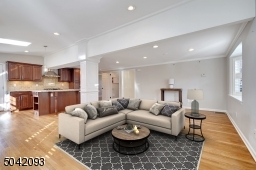 Open floor plan features freshly finished floors throughout.