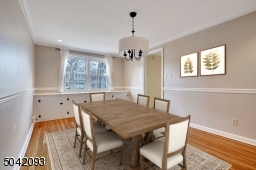 Formal Dining Room features custom built in cabinetry and encompassing chair rail.