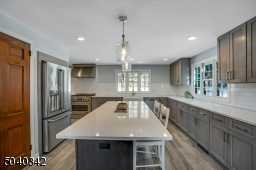 Quartz counter tops, heated porcelain flooring is just the start to this amazing kitchen.