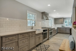 I love the charming details in this home, like the farm sink and and SS exhaust hood.
