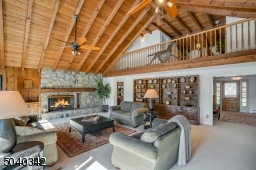 The beautiful stone fireplace, soaring beamed ceilings set the tone for amazing entertaining .