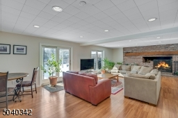 Family Room , enjoy the 3rd fireplace on the lower level, and the radiant heated flooring.  (central A/C not needed).