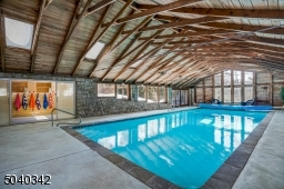 WOW! heated gunite pool (resurfaced 2 years ago). The sliding doors open to a blue stone patio.