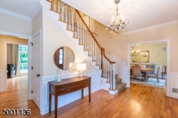 This elegant entryway is flanked by a Dining Room on one side and formal living room with transom windows and a gas fireplace on the other side