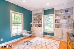 First floor office or optional 6th bedroom with charming built-ins and recessed lighting  conveniently located next to private first floor full bath, additional powder room on first floor for guests