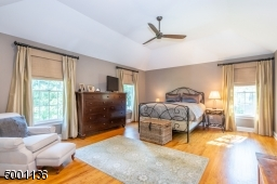 Master Suite with Tray Ceilings, an additional sitting room or second office with french doors for privacy, and his & hers walk in closets