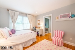 This bedroom features a closet and dressing area,  also opens to the Jack & Jill full bathroom