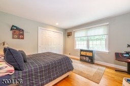 Great views of the yard from this well sized bedroom
