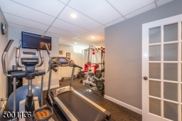 Lower Level private gym conveniently  located next to powder room