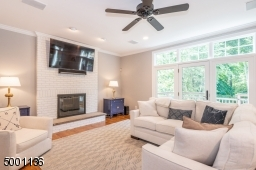 Family Room with wood burning FP, open to eat-in Kitchen with doors to deck, allowing a great flow for entertaining guests