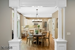 Sophisticated Moldings and fully appointed kitchen