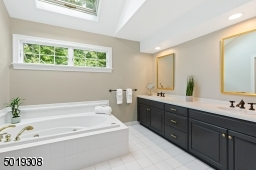 Luxury at it's best and filled with sun from private window and skylight.