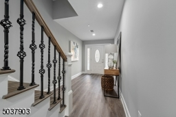 Decorative railings, ring door bell, wifi garage door opener, beautiful wide plank flooring.