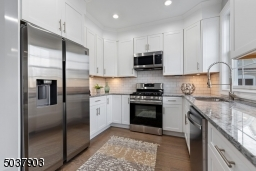 New stainless appliance package with warranty, Moon River Granite countertop, White Shaker Face soft cabinet, custom faucet undermount lighting. Separate breakfast area with  oversize door to balcony for grilling.