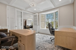 The private Home Office with double French privacy doors and coffered ceiling is the perfect spot for Zoom calls and extra study space.