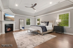 The sumptuous Primary Wing retreat features a vaulted tray ceiling w/ intricate moldings, gas fireplace and large custom walk-in closet plus a luxurious Primary Bathroom