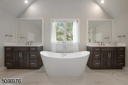 A luxurious Primary Bathroom w/ tray ceiling, two vanities w/ quartz countertops & two built-in linen closets. A crisp white soaking tub and large walk-in frameless glass shower completes this room. All finishes are modern and on trend.