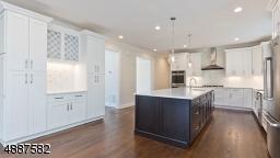 Quartz Counters, Custom Cabinetry, Jenn-Air Appliances