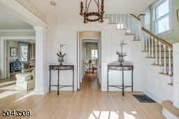 Gracious & Inviting with Access to a Coat Closet, Powder Room & Kitchen