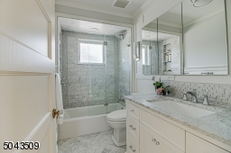 Custom Cabinetry, Marble Tile & Countertop