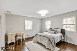 Bedroom 2 features hardwood floors, recessed lights, 2 windows and fitted closet