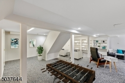Lower Level features wall-to-wall carpeting, Media Room with built-in shelves