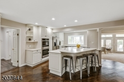 Recessed lights, open display shelves, workspace w/ glass doors, island w/seating for 4 & extra prep sink, bay window over sink & step down to eat-in Breakfast Area. A large bay window opening to Family RM w/built-in storage