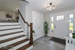 Spacious foyer with double closet