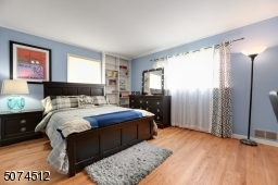 Large  Master bedroom with built-in shelves