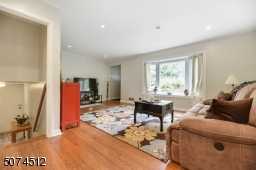 From backdoor to the laundry room at the ground floor with a few steps open to the eat-in kitchen to the Living Room