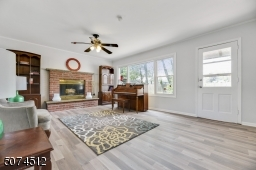 Spectacular Family room with a wood-burning fireplace and new brand new fooring and freshly painted