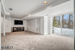 Great lower level room perfect for movies or games with slider to yard
