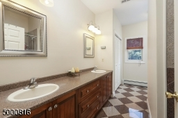 Double sinks, large shower, separate linen closet (there is another linen closet in the hall)