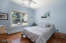 Hardwood floors, lighted ceiling fan and double closet