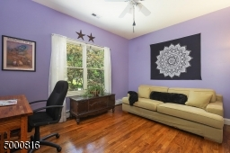 Currently used as an office; hardwood floors, lighted ceiling fan and double closet