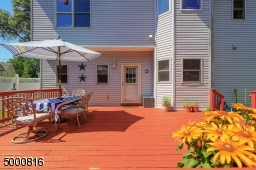 Large sunny deck for entertaining and container gardening.