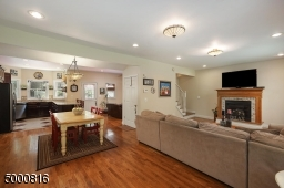 Note the gas fireplace in the living room and the beautiful hardwood floors
